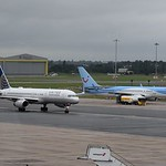 United Airlines Boeing 757-200 N26123 arrives at Birmingham Airport from Newark while TUI 757 G-OOBN receives attention.